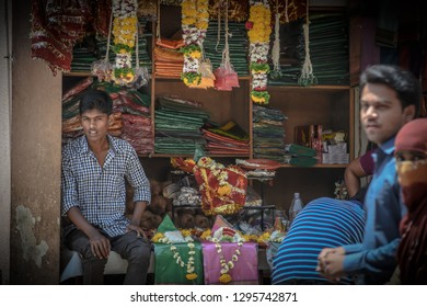 Pune,India - April 26 2015 : Indian saleman sit in front of his store in Chaturshringi Mandir.