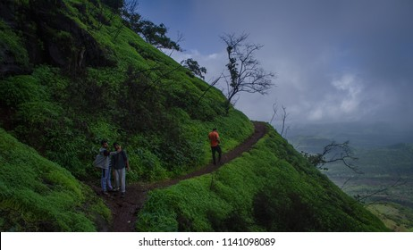 Pune,Maharashtra, INDIA - JUL 2018: Trekking on the Rajgadh fort in Pune. Monsoon treks in the western ghats are very popular among youths in Pune.