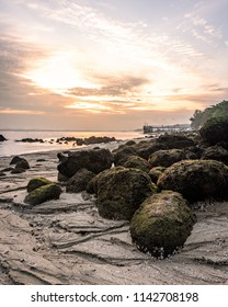 Punggol beach at sunrise with rocks in the foregroundd