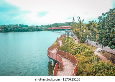 Punggol, Singapore, 3 March 2017: The Lorong Halus bridge, red design bridge pedestrian connecting Punggol town to Lorong Halus Wetland. (Unseen in Singapore, process in HDR style)