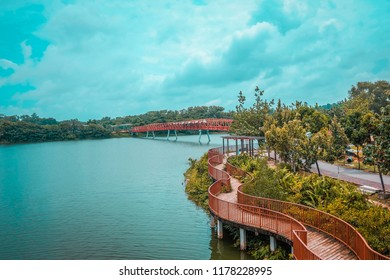 Punggol, Singapore, 3 March 2017: The Lorong Halus bridge, red design bridge pedestrian connecting Punggol town to Lorong Halus Wetland. (Unseen in Singapore, process in orenge and teal HDR)