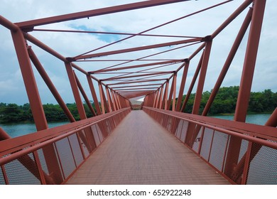 Punggol, Singapore, 3 March 2017: The Lorong Halus bridge, red design bridge pedestrian connecting Punggol town to Lorong Halus Wetland. (Unseen in Singapore)