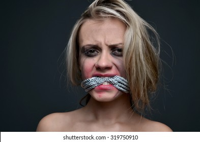 punished woman with rope in mouth