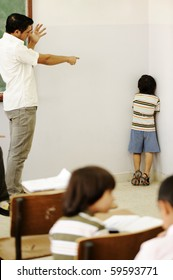Punishing children in classroom, angry teacher and kid in corner