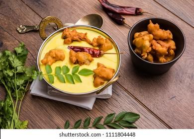 Punjabi Kadhi Pakoda or curry Pakora, Indian cuisine served in a bowl or karahi, selective focus