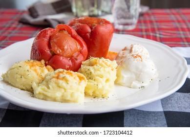 Punjene paprike - traditional Serbian dish Stuffed peppers served with mashed potatoes and cream cheese called Kajmak