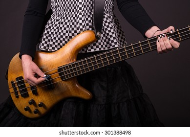 Punk Rock Girl Playing Bass Guitar Closeup