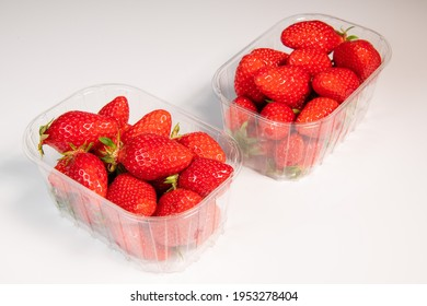 Punnet of strawberries isolated on white background