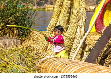 Puno / Peru - 11 04 2018: Little girl of Uros floating islands in Peru