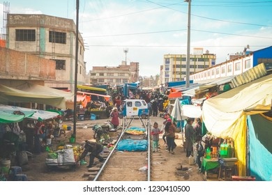 Puno, Peru- August 16th, 2018: The Juliaca Railway Flea Market Peru. People have to briefly move off the tracks while the Andean Explorer train from Puno to Cusco passes through.