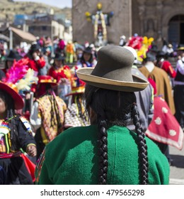 Puno, Peru - August 20, 2016: Native people from peruvian city dressed in colorful clothing perform traditional dance in a religious celebration. Peru, South America.