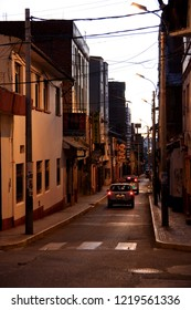 Puno, Peru - August 9th 2012: A car driving down a typical street in Puno after sunset