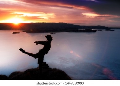 PUNO, PERU - FEB 4: Silhouette of male ballet dancer posing above Lake Titicaca on Isla Amantani in Peru on February 4, 2017.