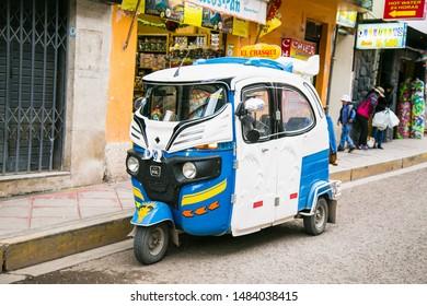 Puno, Peru - Jun 5, 2019: Rickshaw also called Tuk Tuk in Puno. Peru