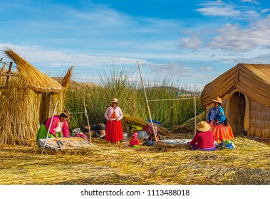 PUNO, PERU - JUNE 18, 2013: A family of the Uros indigenous group living on floating islands made of Totora reed in the Titicaca Lake between Peru and Bolivia.