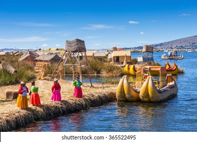 PUNO, PERU - MAY 14, 2015: Unidentified women in traditional dresses welcome tourists in Uros Island.