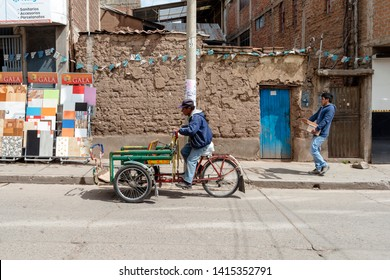 PUNO, PERU - NOVEMBER 5: daily life scenery with busy people from street in Puno, Peru on November 5, 2018