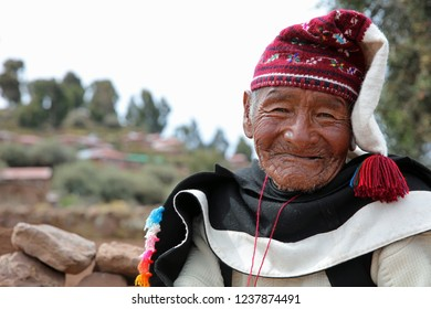 Puno, Peru – October 24, 2018: Unidentified Man in traditional outfit specific for the Taquile Island, while knitting .  Taquile Island is on the Lake Titicaca, 45 km offshore from the city of Puno