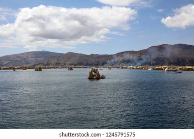Puno, Peru – October 24, 2018: Reed Boat with native People at Uros Floating Islands in Lake Titicaca. Peru