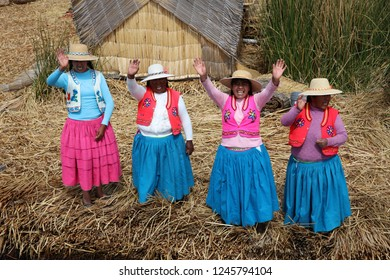 Puno, Peru – October 24, 2018: Native People at Uros Floating Islands in Lake Titicaca. Peru