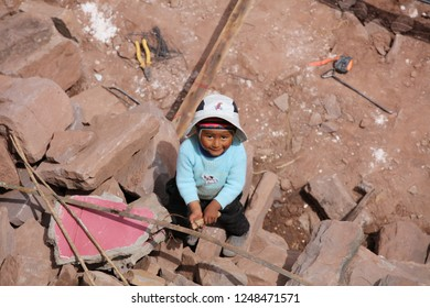 Puno, Peru – October 24, 2018: Unidentified Child on Taquile Island is playing on a Construction Area.  Taquile Island is on the Lake Titicaca, 45 km offshore from the city of Puno. Peru