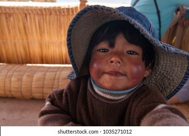 Puno, Peru - September 17 2008: The local peruvian child on Isla de Amantani, where tourists would stay over with the indigenous villagers.