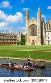 Punt trip (sightseeing with boat) along River Cam near Kings College in the city of Cambridge, England.