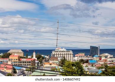 PUNTA ARENAS, CHILE - February 2019: Aerial view of the Punta Arenas town with Strait of Magellan on background (Mirador Cerro De La Cruz). Skyline of Punta Arenas, Patagonia Chilena, Chile