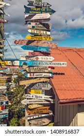 PUNTA ARENAS, CHILE - February 2019: Mileage Distance Signs near the Mirador in Punta Arenas, Chile