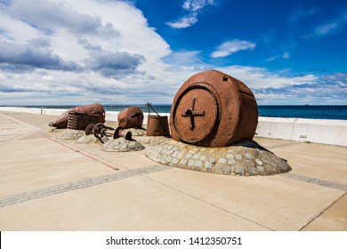 PUNTA ARENAS, CHILE - February 2019: Old rust underwater camera, monument on the Punta Arenas quay, dedicated to the explorers of the ocean in Punta Arenas, Chile