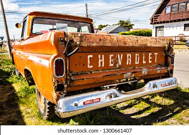 PUNTA ARENAS, CHILE - January 2019:  Old vintage Chevrolet car parked on the street of Punta Arenas town, Patagonia, Chile