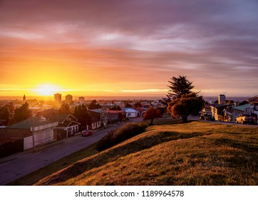 PUNTA ARENAS, MAGALLANES PROVINCE, PATAGONIA, CHILE - MARCH 26, 2018: View over city towards Strait of Magellan at sunrise.