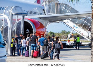 Punta Cana, Dominican Republic - December 24, 2018: A lineup of tourists await screening before entering flight at the Punta Cana International Airport