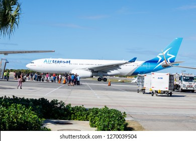 Punta Cana, Dominican Republic - December 24, 2018: An Air Transat Passenger Jet at the Punta Cana International Airport on tarmac awaiting cargo and passengers