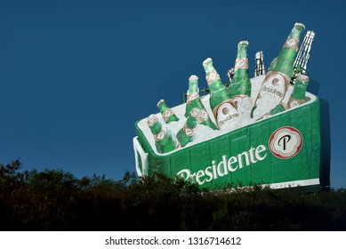 Punta Cana, Dominican Republic - February 7, 2019: Billboard for Presidente the popular beer brewed in the Dominican Republic and exported to several other countries.