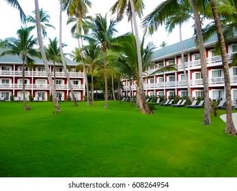 Punta Cana, Dominican republic - February 04, 2013: The Barcelo Bavaro Beach hotel under palms