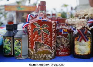 PUNTA CANA, DOMINICAN REPUBLIC - JANUARY 2, 2015:  Mamajuana souvenir bottles in Punta Cana. Mamajuana is a home made aphrodisiac drink made from medicinal roots in Dominican Republic