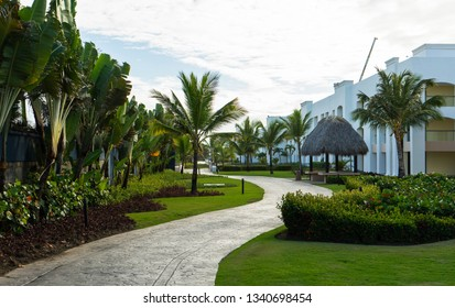 Punta Cana, Dominican Republic - March 10, 2019: Walking through the beautiful Hard Rock Resort pathways in Punta Cana, surrounded by palm trees and tropical scenery.