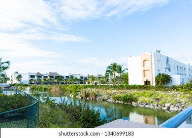 Punta Cana, Dominican Republic - March 12, 2019: The large property of the Hard Rock Resort in Punta Cana with rivers, bridges, a pathway around the property leading to the pools and various buildings