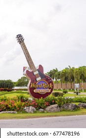 "PUNTA CANA, DOMINICAN REPUBLIC - MAY 22, 2017: The signboard of the hotel and casino. Sculpture guitar ""Hard Rock"". Copy space for text"