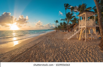 Punta Cana sunrise over Caribbean beach in  with lifeguard station.