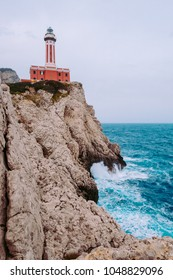 The Punta Carena lighthouse at stormy weather, Capri, Italy.