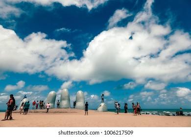 Punta del Este, Uruguay - 14 January 2014: La Mano (The Hand) is a sculpture located on Parada 1 at Brava Beach in Punta del Este, a popular resort town in Uruguay.