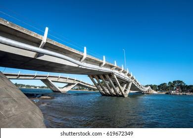 Punta del Este, Uruguay - April 1, 2017: Wavy-gravy bridge was created by the engineer Leonel Viera to expand the area of Punta del Este, located in La Barra, Maldonado province