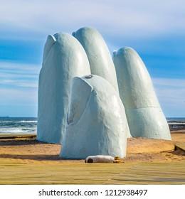 PUNTA DEL ESTE, URUGUAY, OCTOBER - 2018 - Fingers most famous landmark monument located at la brava beach in punta del este city, Uruguay