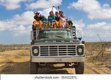 PUNTA GALLINAS, COLOMBIA, JANUARY 16: Indian Wayuu Colombian traveling on a truck and working in a salt mine in La Guajira, Colombia 2014.
