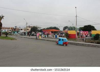 Punta Hermosa/Lima/Peru - January, 22, 2016: little colorful car passing by Punta Hermosa street fair