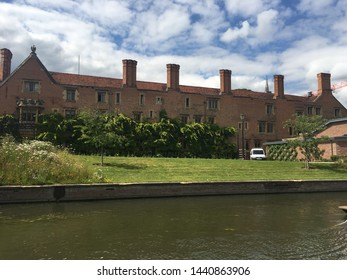 punting in cambridge on the lake looking out on a old building