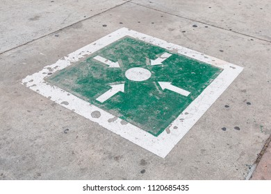 A punto de reunion (meeting point) on a sidewalk in Tijuana, Baja California, Mexico.  The illustrations have been placed in Mexican cities as an evacuation meeting point following a major disaster.