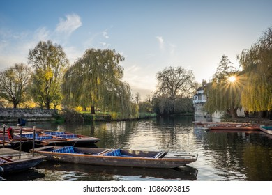Punts on the river Cam in Cambridge, England on a sunny spring day. Taken from water level.